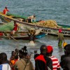 Image of sole fishers in the Gambia bring catch to beach