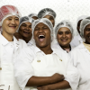 Group of female seafood processors laughing and smiling